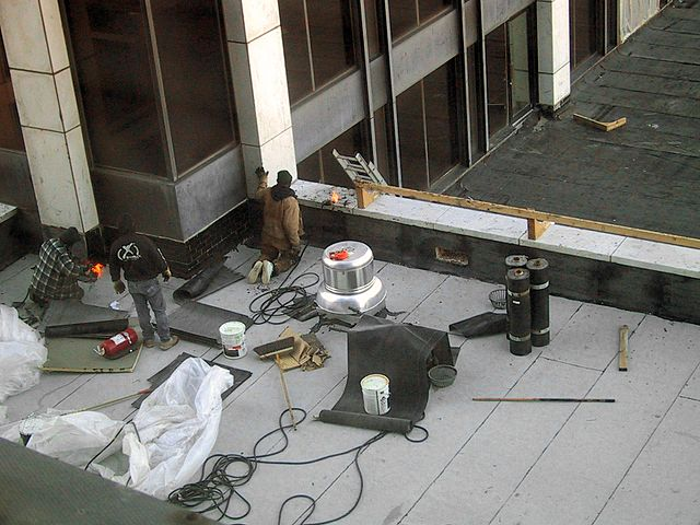roofing company in Vancouver BC working on commercial roof
